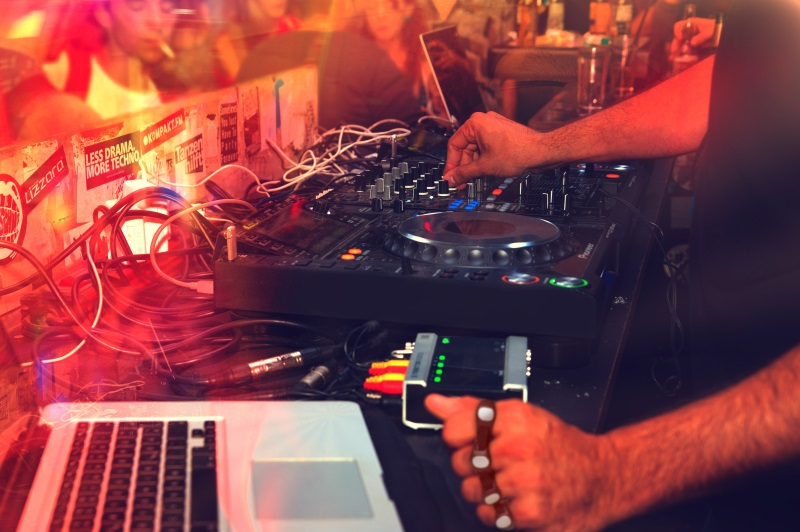 A dj uses tap to cue sound for his performance