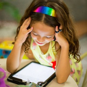 young girl uses tap to learn the ABCs